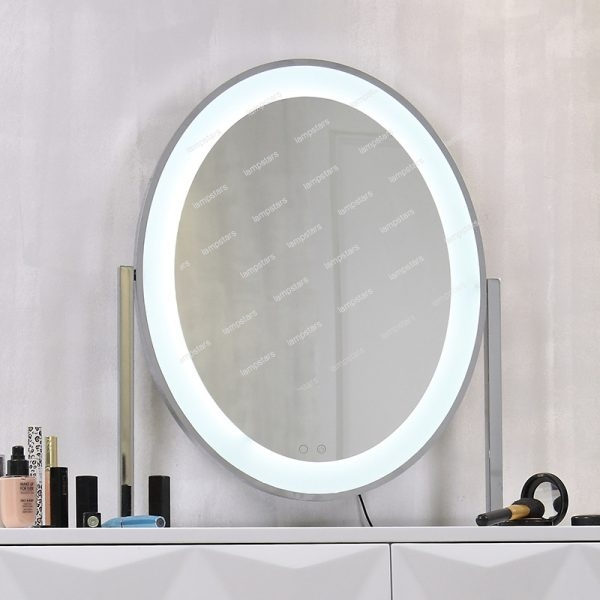 big mirror with lights around i