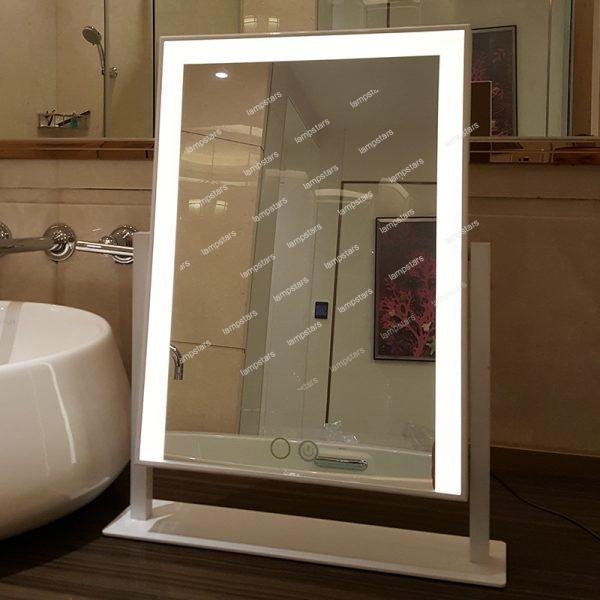 vanity mirror with lights around it